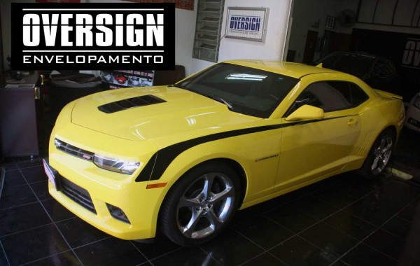 2014 Camaro yellow, rear spoiler and black piano.